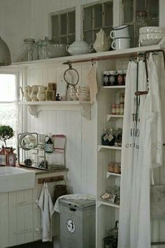 Make a curtain from scarves for the pantry shelves next to the washer/dryer.