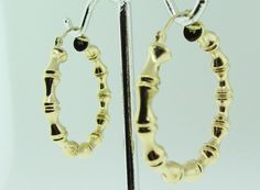 14 K gold bamboo hoop earrings. by VintageJewelryBazaar on Etsy