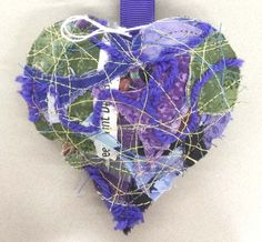 I was walking to the library & I passed by a tree with this quilted heart hanging on one of the branches. I held it to take a closer look because the colors caught my attention. One of the primary colors it's made of is purple & it is the color of pancreatic cancer awareness. My mom passed away this past summer to pancreatic cancer. This heart is a beautiful reminder of her and I'm so grateful I found it. Thank you. #IFAQH #ifoundaquiltedheart