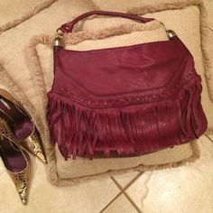 "B Makowsky burgundy leather bag This bag is a great size, add the fringe for attitude and the burgundy  color for style.  So many  details, multiple zippered compartments, supple leather, braided detail. Strap 20"", perfect addition and style for your very own closet! Great condition:) rings available on my closet. B makowsky Bags Totes"