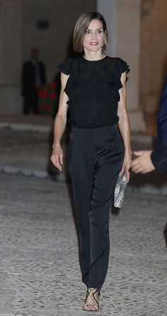 Queen Letizia of Spain in Mango top & Hugo Boss pants with Magrit sandals and Adolfo Dominguez bag - Reception for the authorities & people of Balears at La Almudaina Palace, Palma de Mallorca, August 2015
