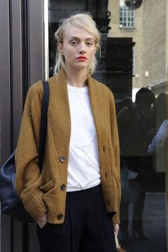 Poppy red lips, mustard cardigan, white top, backpack & black pants #style #fashion #streetstyle