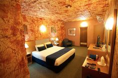 Desert Cave Hotel – Coober Pedy, Australia this is also a good idea of local art i feel the texture on the walls brightens up the room gives a sense of warmth makes u fell relaxed