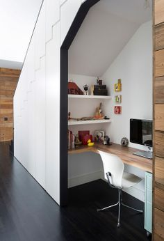 What a great use of under-the-stairway space! A hidden closet sits just to the left of the home office making this a zero-space-waste, high-use design. Another home run design from Hugh Jefferson Randolph Architects.