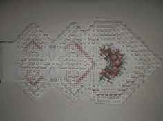 This is a hardanger piece that was designed by Emie Bishop (Cross 'n Patch Designs)