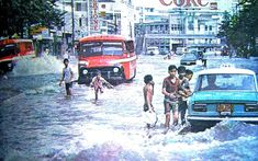 Children play in flood waters along Nicanor Reyes street facing España street in Historical Landmarks, Historical Photos, Jeepney, Philippines Culture, Filipiniana, Manila, Back In The Day, Old Photos, Kids Playing