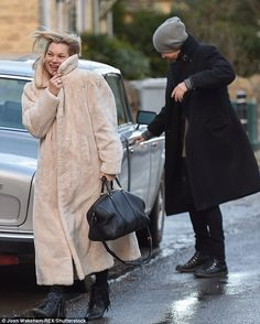Plenty to smile about: The supermodel, 41, seemed to be putting her turbulent year behind her once and for all as she shared a joke with her magazine publisher ex, 44, on Christmas Eve