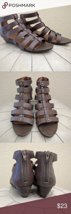 Lucky Brand gladiator wedge sandals size 9 1/2 These beautiful and comfortable gladiator sandals are funky and fun. The short wedge lengthens the leg but is easy to walk in. They are in great condition and come is a versatile putty color that appears both gray and brown. Let me know if you have any questions! Lucky Brand Shoes Sandals