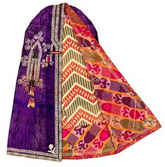 Uzbekistan, Woman's paranja, c.1900. Russian embossed silk velvet; silk hand- embroidery; applied handwoven and cross-stitched silk trim; silk tassels; Russian printed faux-ikat cotton lining; atlas (satin-weave) ikat facing.