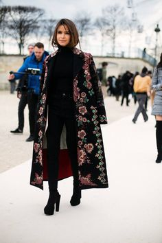 Miroslava Duma in total black look with embroidered long Valentino coat