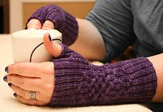 The ribbing on these cabled mitts gives them a comfortable fit for a range of sizes, while the cables provide elegant shaping and style. The original thumb gusset design lends them a unique look, while having the gusset set on the palm affords a more natural fit.  Knitting these up with the lighter sock yarn and smaller needles creates a fine, soft fabric that is a joy to wear.
