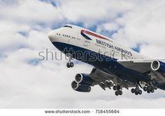 LONDON, UK - AUGUST, 6 2013; A British Airways Airbus Boeing 747 landing at London Heathrow Airport