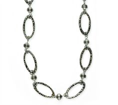 """Rome - """"Large, antique silver hoops are hammered for a versatile necklace that adds interest as a belt, bracelet or boot bling. It can also be combined with Milano as a layered necklace or belt."""" www.jewelrystar.mialisia.com"""