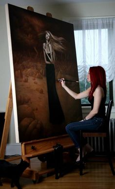 Lori Earley, painting with her cats.