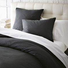 Swiss Dot Duvet Cover + Shams in Slate from West Elm. Great for a boys room layered with white or off white.