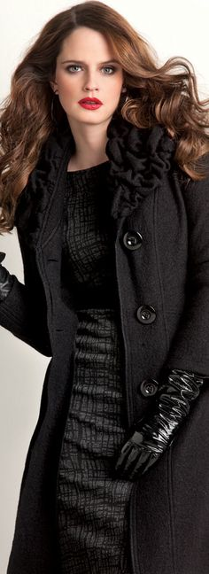 The coat works simply because of the long black leather gloves.