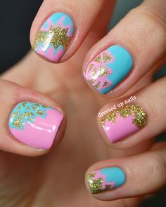 pink, blue, and gold glitter nails.