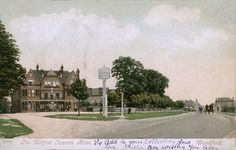 Postcard, posted 11th May 1906, showing view of the Wilford Lawson Temperance Hotel and along the High Road, Woodford.