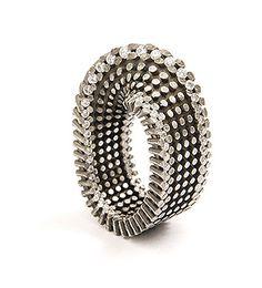 Yael Herman. Ring: Mobius Ribbon, 2007. 18k gray gold ring set with diamonds. 1.2 x 3.3 x 2.2 cm.