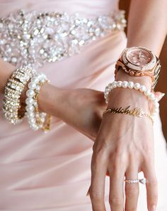 This @Mandy Dewey Seasons Resorts Bali bride accessorized with bracelets and a watch.