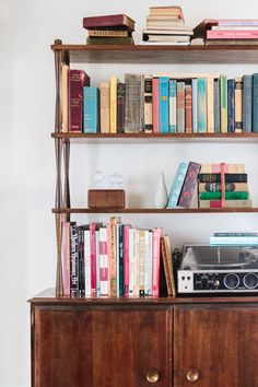 The vintage bookshelf was a thrift store find. The shelves hold Jesse's collection of design books and his record player, as well as some of my history and English books.