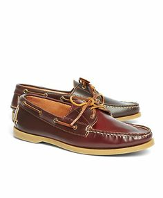 Boat shoes, made from genuine cordovan leather, is a uniquely modern interpretation of a preppy favorite. Features rawhide laces and a rubber sole. Hand-stitched. Antique brass eyelets and buckle. Unlined. Tanned and handmade in the USA.