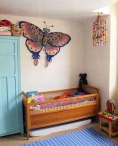 Giant butterfly and pompom garland make it! #estella #kids #decor