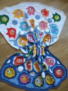 This stunning little blanket is just so cute. A blanket full of colorful fishes to snuggle up your little one.This blanket is made of various colors granny squares and granny square are shaped like fishes. It would be very nice and interesting for your baby. The blanket could be made in different colors and sizes.Measurements of the blanket are : Height : 105 cm = 41' inch. Width : 84 cm = 33' inch.The pattern includes plenty of pictures which will help you htrough step by step.