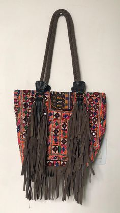 Beautiful boho banjara embroidered handcrafted bag perfect for office or shopping day out!Accessorise it up with a white shirt and blue jeans. Tie Dye Coats, Customised Denim Jacket, Festival Coats, White Shirt And Blue Jeans, Vintage Patches, Embroidered Bag, Shopping Day, Vintage Textiles, Handmade Bags