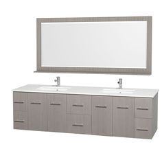 The Centra bathroom vanity from the Wyndham Collection Designer Series by Christopher Grubb arrives with twin porcelain undermount sinks set in a white man-made stone counter top. Grey oak-finished cabinets and drawers provide the base of this set.