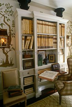 Alidad ~ In the library a built-in bookcase is filled with a collection of antiquarian books
