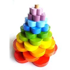 A colourful rainbow flower stacker that creates hours of fun for toddlers. Toddler Fun, Toddler Toys, Kids Toys, Hape Toys, Kids Toy Store, Organic Baby Toys, Dolls Prams, Wooden Baby Toys, Stacking Toys