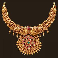 22 karat heavy looking gold short necklace in nagas or nakshi work. The peacocks design nakshi work  gold choker necklace in gheru...