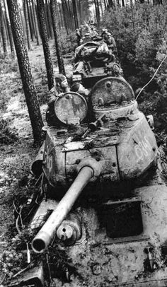A column of T-34-85 medium tanks in the forest during the Battle of Berlin
