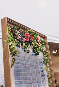 Framed Floral Wedding Seating Chart and Escort Card Display | Brides.com