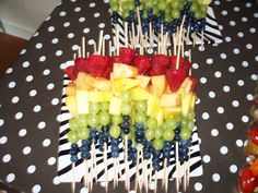 Country bridal shower food: Rainbow fruit skewers on polka dot table cloth
