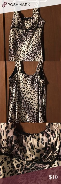 Satin cheetah print sleeveless top Sleeveless tank top style top. Cheetah print colors are purple, cream and black. Great to wear under a cardigan. Tops Blouses