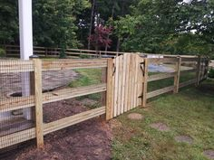 This 48 inch three board paddock wood #fence with black mesh wire is the perfect way to protect any pool from pests. Repin if this pool area inspires you. | Manassas VA | Beitzell Fence