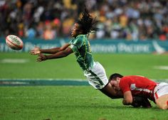 South Africa's Cecil Afrika is tackled in the game against Wales during the Hong Kong Rugby Sevens tournament. (AFP)
