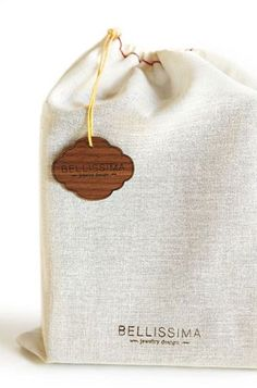 sheer fabric gift bag packaging with lasered wooden tags