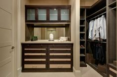 A walk-in closet becomes a dressing room by adding drawers. The two-tone effect seen here is created by adding linen inserts to the drawer faces. #closet #closetdrawers Learn more: http://www.closetfactory.com/