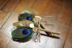 Unique boutineers made with burlap, peacock feathers, twine and buttons