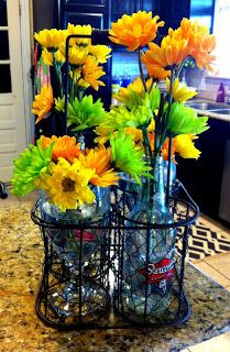 Use soda bottles and tea glasses for a Spring flower arrangement! Or use my small southern loving vases