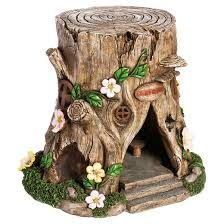 Image result for tree stump fairy house