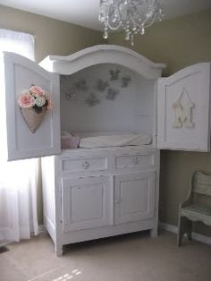 Diaper Changing Station from an upcycled entertainment center.. what's not to like?  its pretty, its functional, its storage - and it grows with the child!  - no more diaper changing? add an expansion rod and hang their toddler clothes! - put shelves for storing toys and books. Ready for a tv.. put one in.. its ready to go!