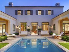 contemporary pool, furniture, black framed doors and windows.