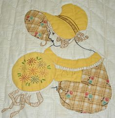 "Fancy Sunbonnet Sue spotted at the 2008 Chickasha quilt show, photo by Darcy Ashton: ""Not only do we get to see Sue's face, but it looks like she is working on some embroidery designs in a hoop."""