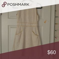 Tory Burch dress White Tory Burch dress.with yellow detailing around pockets, And waist area. Very gently used, I just grew out of it. Tory Burch Dresses Mini