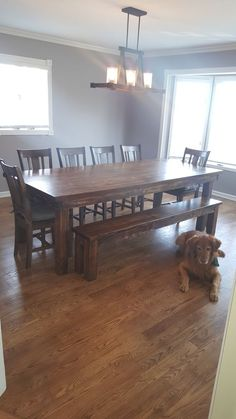 """James+James 8'x42"""" Farmhouse Table with a custom Red Oak table top. This table has a traditional, boarded table top all stained in Vintage Dark Walnut. Pictured with matching Farmhouse Bench and 6 matching William Dining Chairs."""