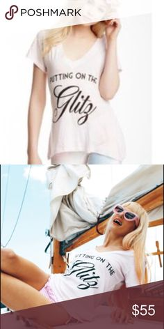 Wildfox Putting on the glitz Adorable cotton tee in our favorite Wildfox fit! V-neck. Short sleeves. Front graphic. Form fitting small. Not oversized. Comfortable cotton shapes a glammed-up screenprint tee cut in a relaxed V-neck silhouette. Wildfox Tops Tees - Short Sleeve